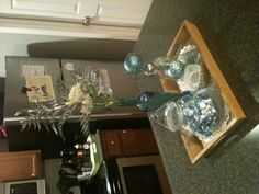 Christmas decorations on our kitchen island.  I love to keep everything confined to a tray for easy moving/ cleaning.
