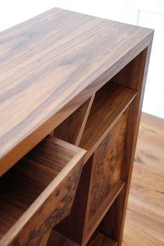 SQ1 Walnut tree styled bookcase with Burr walnut drawer detail.