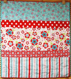 I'm equally intrigued and intimidated by hand quilting...love this baby quilt with the happy material!