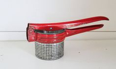 Vintage potato ricer, red potato ricer, red-handled potato ricer, retro potato ricer, farmhouse kitchen utensils, rustic potato ricer, red