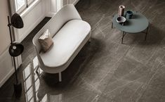 Introducing Grandi Marmi. A new marble-effect porcelain tile from Italy. Marble Effect, Porcelain Tile, Tiles, Italy, Colours, Chair, Furniture, Home Decor, Room Tiles