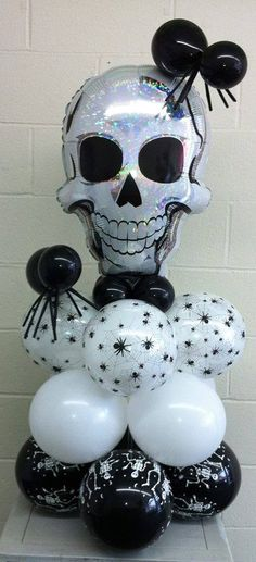 Spooky Halloween Skull Pedestal.  This makes a great centerpiece or gift delivery.