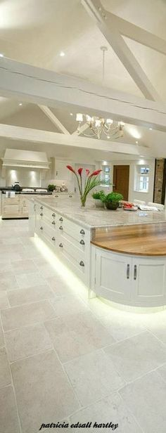 Kelly Green painted island with butcher block top. I love the size and style of this island.