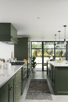 Modern Kitchen Interior Remodeling Green light shaker kitchen with Crittal-style windows - Confused about where to start with your kitchen extension project? From budgeting to planning permission, this article will tell you all you need to know Devol Kitchens, Home Kitchens, Modern Kitchens, Colorful Kitchens, Tuscan Kitchens, Galley Kitchens, Traditional Kitchens, Contemporary Kitchens, Luxury Kitchens