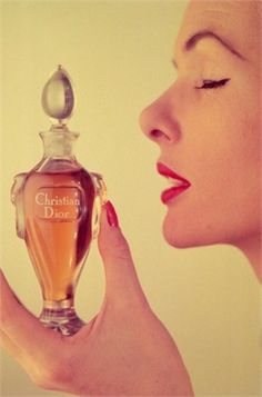 A woman holding a bottle of Miss Dior perfume by Christian Dior, December The half ounce flagon is presented in a Baccarat crystal bottle, and costs 6 pounds, 19 shillings. Get premium, high resolution news photos at Getty Images Perfume Dior, Perfume Hermes, Miss Dior, Perfume Vintage, Vintage Dior, Vintage Hats, Vintage Beauty, Makeup Products, Beauty
