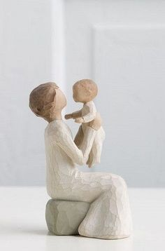 This figurine features a grandmother cradling a young toddler. It's a resin hand-painted figurine. It evokes the feeling of being in your grandmother's arms, and of being loved by your grandmother. Ma