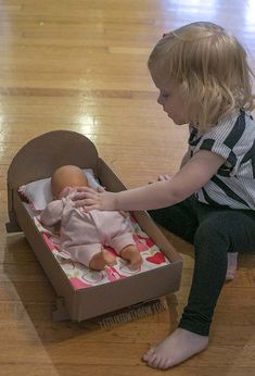 How to make a DIY Doll Crib from an old cardboard box!