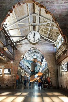 """Sarah_Bumgarner_Chelsea_Market New York photographer Jordan Matter's """"Dancers Among Us"""" project features performers from the Paul Taylor Dance Company performing guerrilla dance moves in iconic Manhattan locations."""