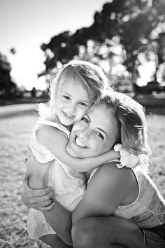 Natural family portrait of mom and daughter. Love how happy they were!  Family photo posing idea: have the daughter and mom's faces close to each other's and have them giggle about something silly!  Joanne Leung photography