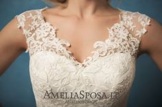 Wedding dress Melania - AmeliaSposa. The less details – the better effect. This result turned to be achievable thanks to the combination of a classic silhouette and trendy laced finish that managed to focus on key elements. These unbelievably beautiful back, V-cleavage and skirt with an openwork train made a wow effect of this gown.