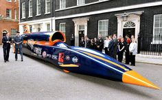 RAF pilot Andy Green shows Prime Minister David Cameron the British-built Bloodhound Jet Car, in which he will try to smash the current world land speed record of 763mph.Picture: JOHN STILLWELL