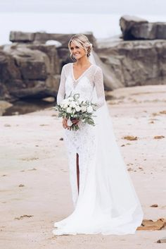 Lauren in our MAI gown, KINGA veil and GAIA earring | Grace Loves Lace