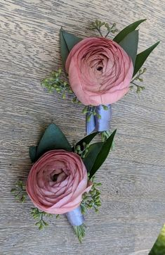 In pale coral pink with eucalyptus and ruscus greens.