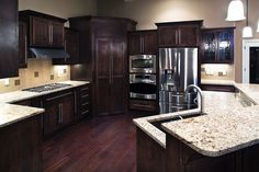 Kitchen - dark cabinets and light countertops....have the floors, & working on new cabinets, backsplash, & granite