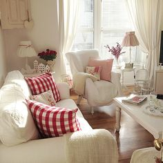 Love the white with pops of red color in this living room - so pretty and cozy!