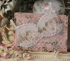 I'm so excited to share this cared I created using Groovi plates designed by Linda Williams. The background is traditional parchment design from a Pergamano magazine, dated November 9 designed by Linda Williams. I felt the lacy feel of the pattern was perfect for the brassiere.