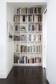 The end of a hall is a great place to add floor-to-ceiling shelving. You won't miss the space, and you'll free up shelving elsewhere in your home.