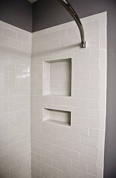 (for third floor or extra guest room bath) White tile shower ideas; white subway tile-shower niche with bullnose edge tile used in lieu of bullnose strip pieces. Also subway tiles turned vertical on edges of shower. Tile Shower Niche, White Subway Tile Bathroom, Subway Tile Showers, Bathroom Showers, Shower Alcove, Tiled Showers, Shower Rod, Upstairs Bathrooms, Laundry In Bathroom