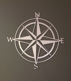 Would love this for the living room. Love the white painted metal on a dark wall. Nautical Compass Rose Metal Wall Art by alkemymetal on Etsy