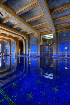 https://flic.kr/p/dUJ9Hb | Roman Pool | The Roman Pool at Hearst castle is a tiled indoor pool decorated with eight statues of Roman gods, goddesses and heroes. The pool appears to be styled after an ancient Roman bath such as the Baths of Caracalla in Rome c. 211-17 CE. The mosaic tiled patterns were inspired by mosaics found in the 5th Century Mausoleum of Galla Placidia in Ravenna, Italy. They are also representative of traditional marine monster themes that can be found in ancient Roman…
