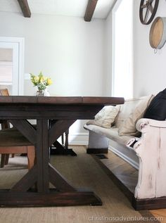 DIY 8 foot farmhouse kitchen table with a distressed pew.  (I love the pew.)