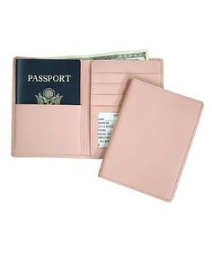 Passport Travel Wallet - a safe place for your passport, 3 credit/business card pockets, ID window for security checks, a full pocket for foreign currency, half depth pocket for U.S. currency and 2 additional pockets for travel papers.