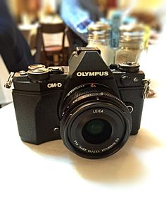 Olympus OMD EM5 Mark ii Looks and feels better without the additional grip... small and very retro. Fabulous camera