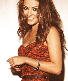 Mila Kunis.....Seems like she would be fun....a guys girl AND a girl's girl!