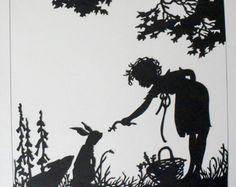 бумаги силуэт ребенка и кролика