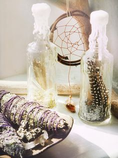 Lavender Wishing Bottles: Clear glass bottle filled with lavender, glitter and a beautiful feather. The top is closed and covered with dripping wax. A stunning decorative piece to add some magick to any surface.