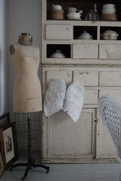 Vintage dress form and angel wings