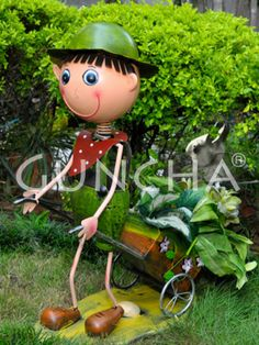 Boy with a cart!! If you love gardening, then this green coloured planter will certainly tickle your fancy at the very first glance