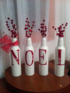 NOEL Christmas deco using spray painted beer bottles and my cricut!