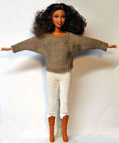 One of the better knitted sweater and pants set I have seen for Barbie sized dolls.
