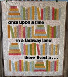 "Read With Me Quilt  This pattern yields a quilt that measures 58"" X 73""   To make this for Ben, I'll add a 4th row of books, and a 4th strip so that it reads:  Once upon a time    Far    Far  Away, as in the Star Wars movies that he loves, to accommodate his 6' frame - LOL!"
