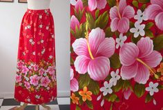 Prettiest vintage 1970s Hawaiian maxi skirt with hot pink hibiscus , and orange, melon and white flowers sprinkles throughout. Skirt is made from