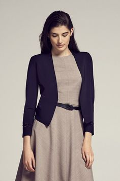 This MM classic has the structure of a jacket but the softness of a cardigan.