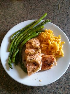 Grilled salmon with every day seasoning and honey mustard sauce for fresh sauteed asparagus and homemade macaroni and cheese.