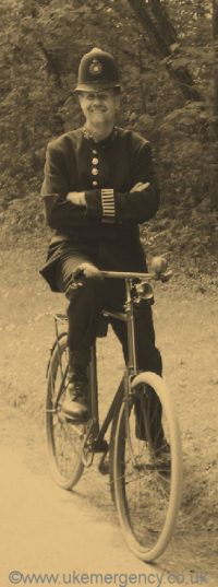 Here is a police officer and cycle from yesteryear. Notice the white bands on the ends of the sleeve that are used to show that he is on duty.