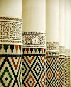 Zellij and Arabesque tiles on columns in Morocco