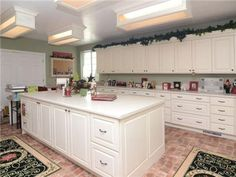 Craftroom. But I would make this the utility room with sink, drip dry area, washer, dryer, fridge and freezer.