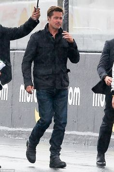 He even looks good in the rain! Brad Pitt gets caught out in a torrential downpour as he prepares to start Le Mans 24 Hours   Daily Mail Online