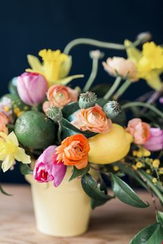 Centerpiece of colorful spring blooms combined with lemon & limes|Citrus Fruits & Summery Vibes -Bridal Shower Ideas|Photographer: Loblee Photography