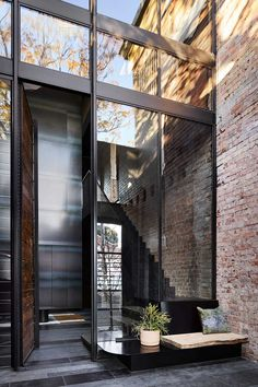 A Non-Traditional Home in Melbourne with an Industrial History Small Front Porches, Front Porch Design, Atrium, Veranda Design, Masonry Construction, Victorian Terrace House, Timber Ceiling, Masonry Wall, Arched Doors