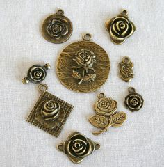 9 Piece Lot of Antique Bronze Rose Charms by VJsBeadsnNeeds, $4.35