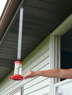 Item #802-24 is a Bird Feeder Hanger Extension that makes it easy to hang and retrieve feeders located outside a window, or on a porch. Using either the included screw in J-hook or one already in place, simply insert the hook from your feeder into the lower hole, then holding the lower end, insert the upper hole into the hook (see pictures). This keeps the feeder away from the house a bit, but still close enough to see hummingbirds and other others up close. Its just as easy to retrieve by…