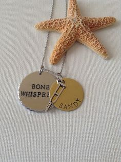 Bone whisperer necklace or keyring, orthopedic tech, orthopedic assistants.  This is a 1-1/4 inch aluminum disc handstamped with Bone Whisperer on it. There is a 1 inch brass disc with the name of your choice. There is a crutch charm hanging in the center of the brass disc. This comes on an 18 inch stainless steel chain which will never tarnish.  Available in keyring, choose from menu above.  ♥♥♥Please leave the name you would like on the brass disc in the notes to seller.  Please note that…