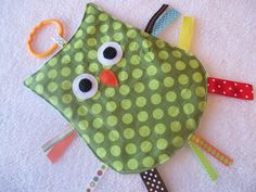 This is a cute owl taggie. I like the ring at the top you can for hanging.