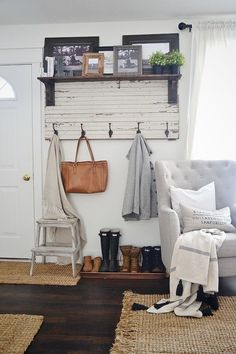 Carve out some space for a (pretty) mudroom with a rustic entryway coat rack and a few storage accessories to complete the nook. | 28 Simple Ways To Improve Your Home In 2017
