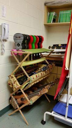 Homemade ukulele storage rack using a clothes drying rack, fabric, pool noodles, velcro, batting, foam